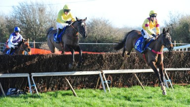 Ballingers Corner (left) and Derek O'Connor jump a fence before winning the five-year-old mares' maiden at Carrigarostig