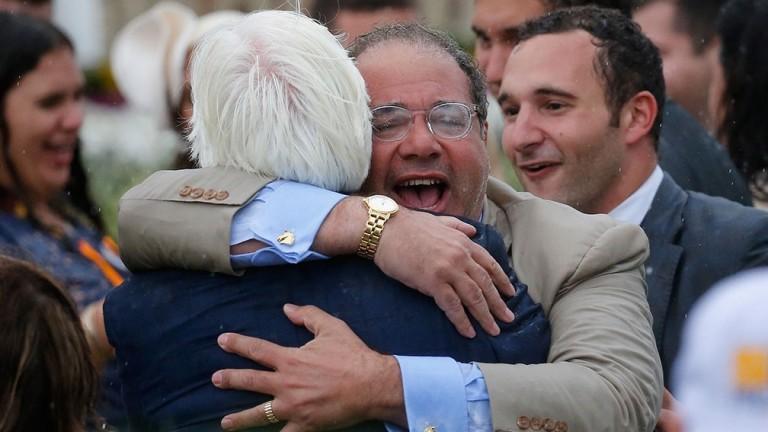 Ahmed Zayat embraces American Pharoah's trainer Bob Baffert