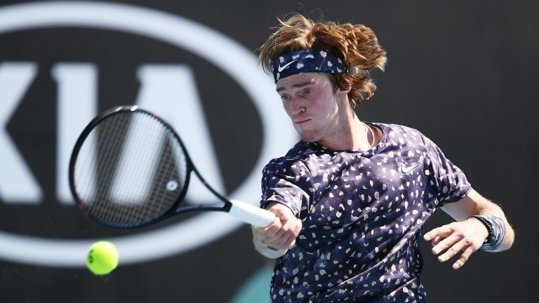 Andrey Rublev plays a forehand during his four-set third-round victory David Goffin