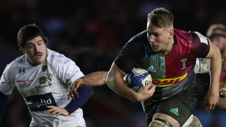 Alex Dombrandt of Harlequins breaks away with the ball against Clermont