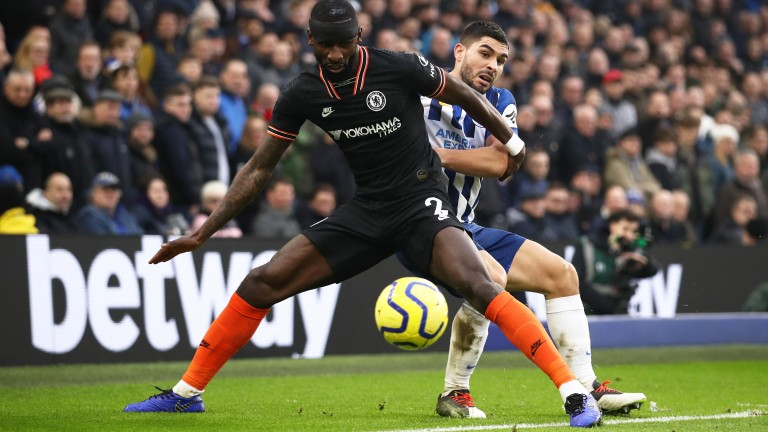 Antonio Rudiger of Chelsea battles for possession with Neal Maupay of Brighton