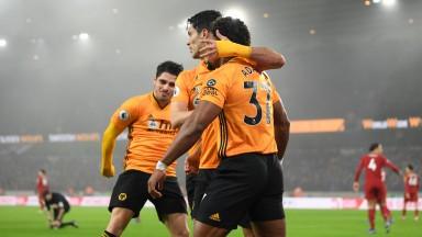 Raul Jimenez of Wolves celebrates with Adama Traore