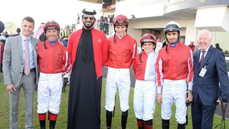 At Sakhir racecourse: (left to right) William Buick, Frankie Dettori, HH Shaikh Nasser bin Hamad Al Khalifa, James Doyle, Rosie Jessop, Rahim Jasim and Allan Smith