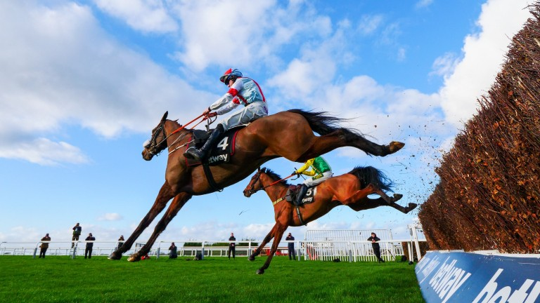 Itchy Feet: clears the last en route to victory in the  Scilly Isles Novices' Chase at Sandown