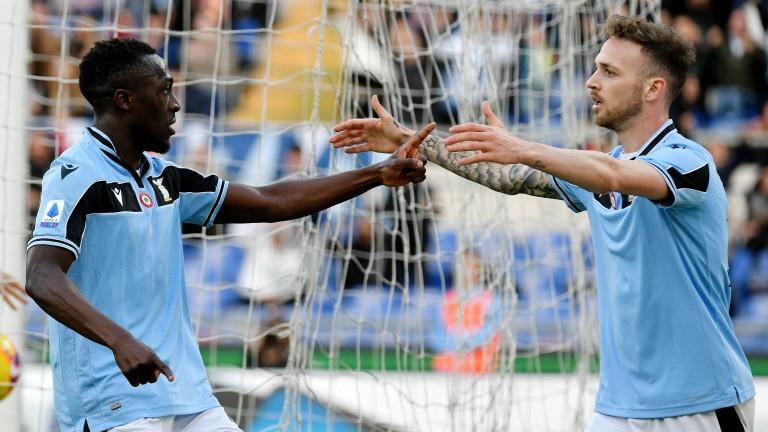 Bobby Adekanye (left) of Lazio celebrates