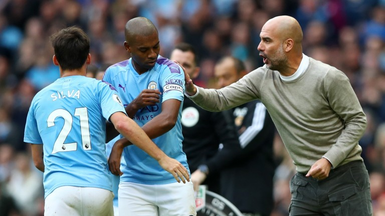 Fernandinho (centre) has been forced to fill in at centre-back this season