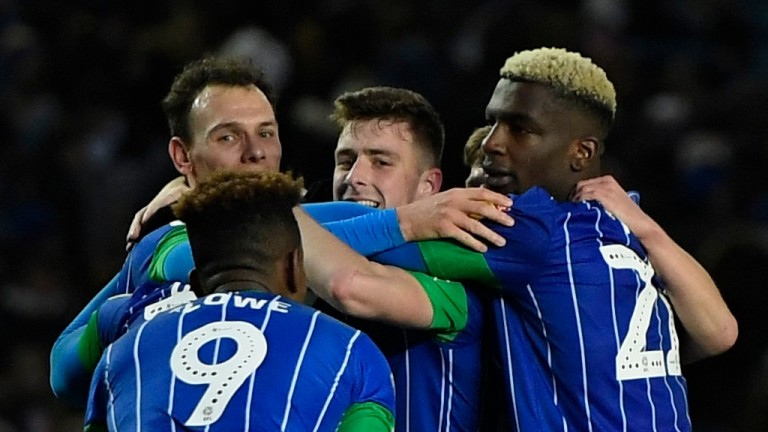 Wigan Athletic players celebrate victory over Leeds United