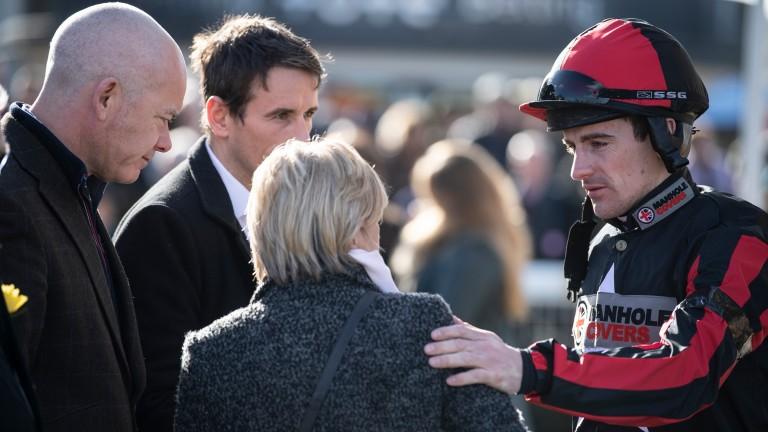 Leading jump jockey Brian Hughes consoles James Banks's mother Beverley Reid