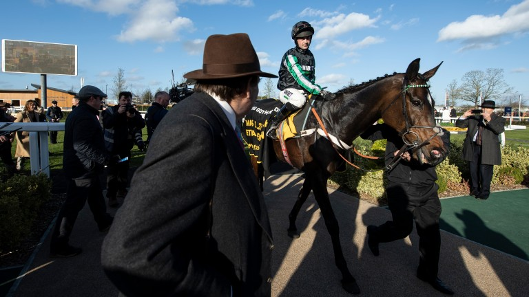 Altior and Nico de Boinville return to the winners'enclosure at Newbury under the watchful eye of a relieved Nicky Henderson
