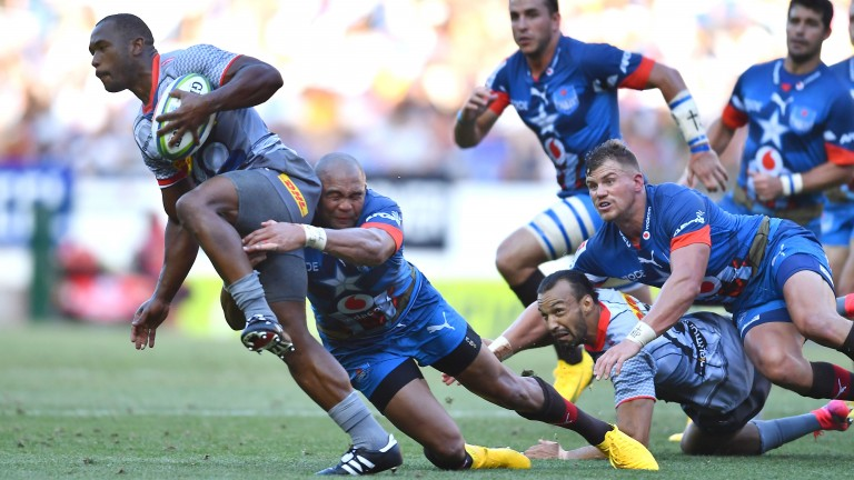 Stormers flyer Sergeal Petersen is tackled by Cornal Hendricks of the Bulls