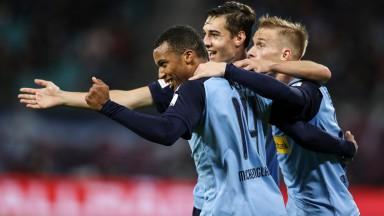 Borussia Monchengladbach players celebrate a goal from Alassane Plea (left)