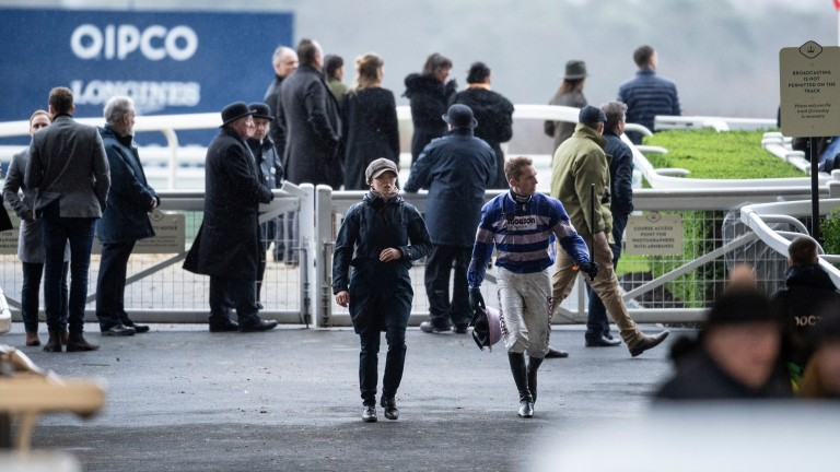 Harry Cobden walks back after falling at the last fence on Cyrname in the Ascot Chase