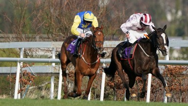 DUBLIN, IRELAND - FEBRUARY 02: Davy Russell riding Black Tears (R) clear the last to win The Irish Stallion Farms EBF Paddy Mullins Mares Handicap Hurdle during the Dublin Racing Festival at Leopardstown Racecourse on February 02, 2020 in Dublin, Ireland.