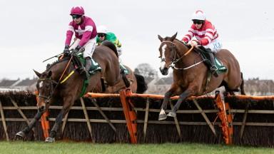 Jason The Militant and Rachael Blackmore battles Beacon Edge to win the Paddy Power Betting Shop Novice Hurdle (Grade 2).Naas.Photo: Patrick McCann/Racing Post 23.02.2020