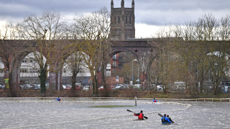 Members of Worcester Canoe Club kayaking on a flooded Worcester Racecourse, as a third consecutive weekend of stormy weather is bringing further flooding misery to already sodden communities.
