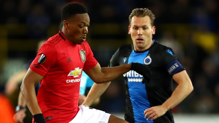 Anthony Martial of Manchester United battles for possession with Ruud Vormer of Club Brugge