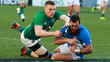 ROME, ITALY - FEBRUARY 24:  Jayden Hayward of Italy is challenged by Andrew Conway during the Guinness Six Nations match between Italy and Ireland at the Stadio Olimpico on February 24, 2019 in Rome, Italy. (Photo by David Rogers/Getty Images)