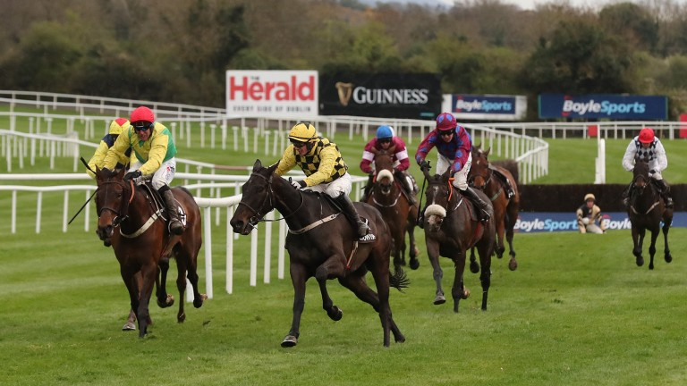 Paul Townend steers leader Al Boum Photo around the final fence at Punchestown in 2018