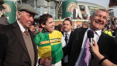 Trevor Hemmings (left) looks on as jockey Jason Maguire and trainer Donald McCain celebrate the 2011 Grand National win of Ballabriggs