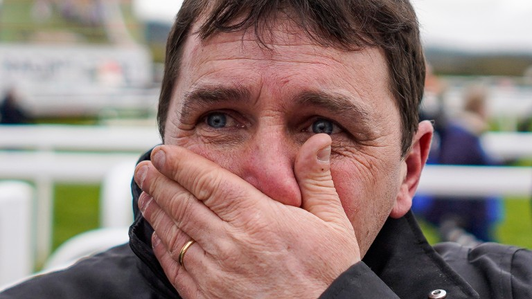 An emotional David Bridgwater celebrates The Conditional's win at Cheltenham last year