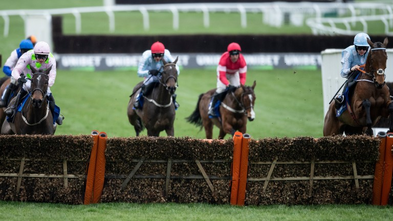 Honeysuckle and Rachael Blackmore (right) clear the last ahead of Benie Des Dieux (left)
