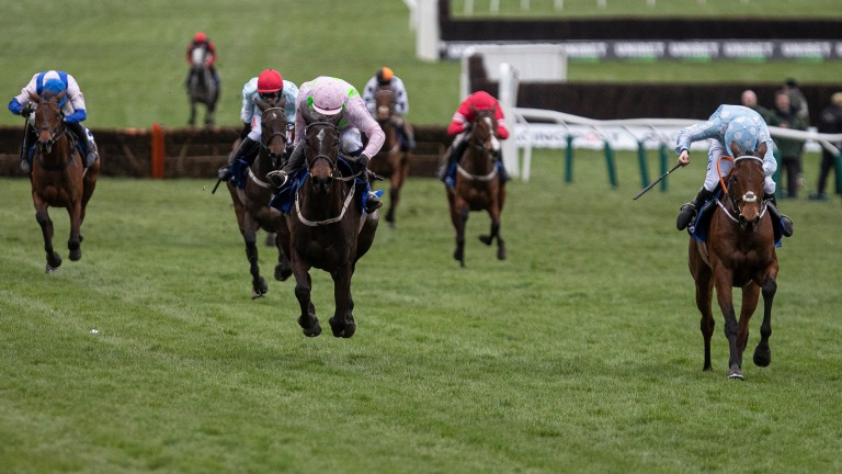 Honeysuckle (right) holds a decisive lead over Benie Des Dieux in the Close Brothers Mares' Hurdle