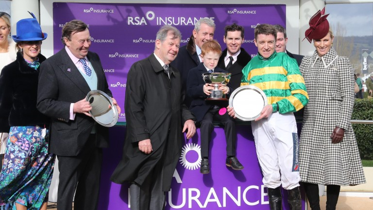 Archie McCoy has the RSA Chase trophy in his hands following Champ's success