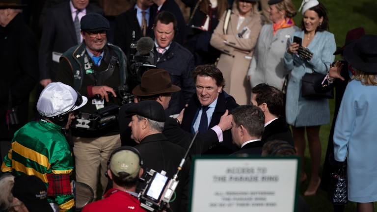 Sir Anthony McCoy is hugged by Nicky Henderson after Champ's thrilling success