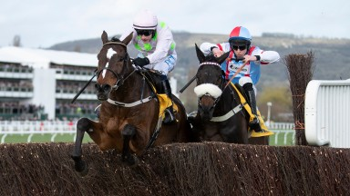 Min (Paul Townend) leads Saint Calvados over the last fence and win the Ryanair ChaseCheltenham 12.3.20 Pic: Edward Whitaker