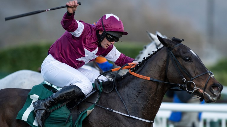 Milan Native and Rob James head for home in the Kim Muir on day three at Cheltenham