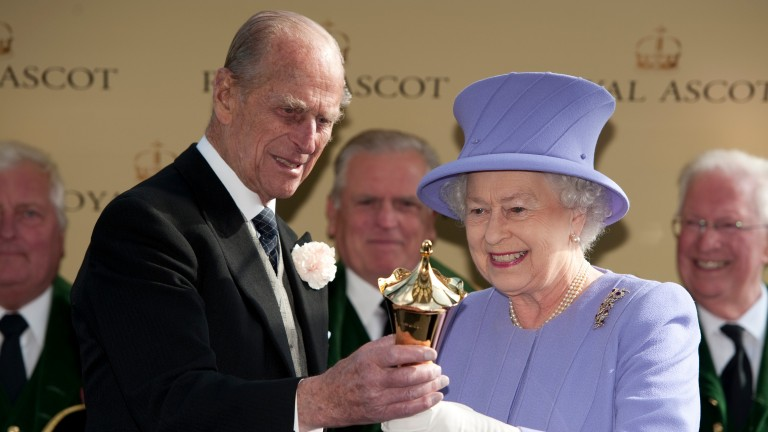 The Queen is presented with the Queen's Vase by the Duke Of Edinburgh after Estimate's win in 2012
