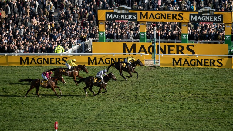 Al Boum Photo (far side) sees off Santini in a pulsating Cheltenham Gold Cup last year