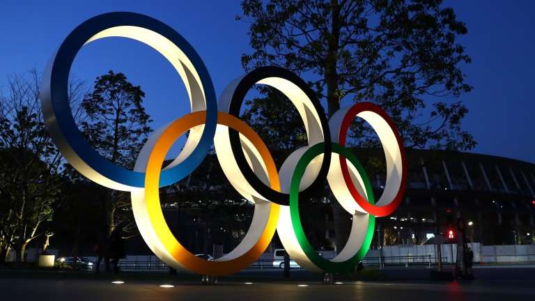 The Olympic rings are seen outside the National Stadium in Tokyo