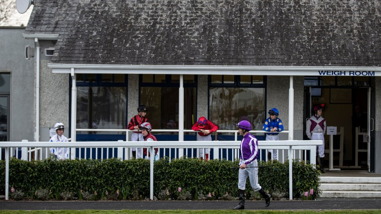 Jockeys keeping a respectable distance at Naas in March: racing returns there on June 8