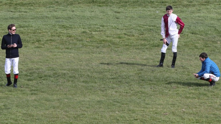 Jockeys at Naas practice social distancing before racing is eventually cancelled