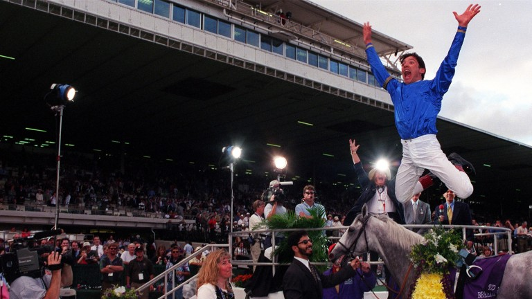 Frankie Dettori performs his traditional flying dismount after winning the 1999 Breeders' Cup Turf at Gulfstream Park on Daylami