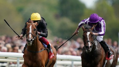 YORK, ENGLAND - MAY 17: Frankie Dettori riding Stradivarius (L) win The Matchbook Yorkshire Cup Stakes from Southern France and Ryan Moore (R) at York Racecourse on May 17, 2019 in York, England. (Photo by Alan Crowhurst/Getty Images)