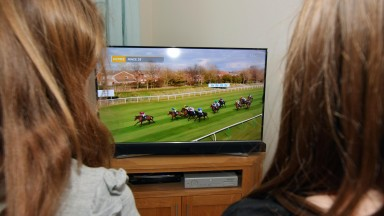Watching the 2020 Virtual Grand National from home due to  coronavirus Covid-19. 04/04/2020.