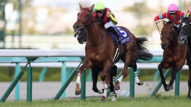 Lucky Lilac and Mirco Demuro hit the front on their way to victory in the G1 Osaka Hai at Hanshin