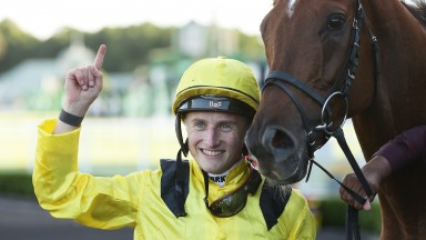SYDNEY, AUSTRALIA - APRIL 11: Tom Marquand riding Addeybb celebrates winning Race 8Longines Queen Elizabeth Stakes during Sydney Racing The Championships Day 2 Queen Elizabeth Stakes Day at Royal Randwick Racecourse on April 11, 2020 in Sydney, Australi