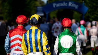 Jockeys walk to the paddock for the 1m handicap at Windsor racecourse 15.7.19Pic: Edward Whitaker