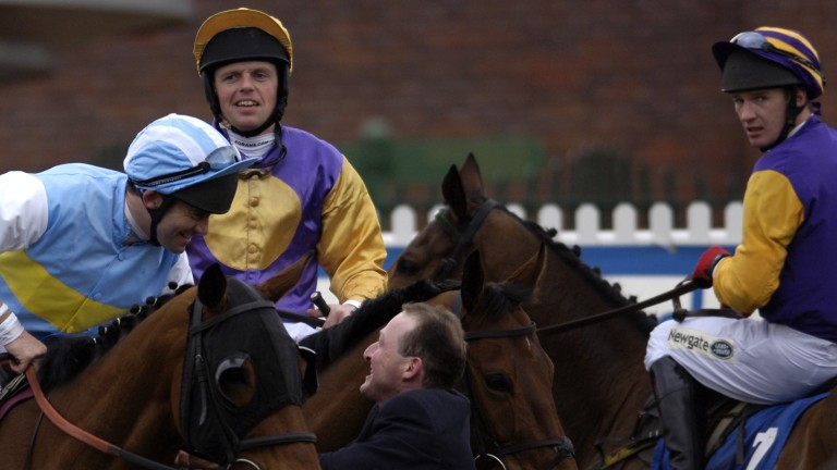 Paul Carberry (right) looks on wistfully at what might have been as Conor O'Dwyer and Hardy Eustace receive the acclaim after the 2005 Champion Hurdle