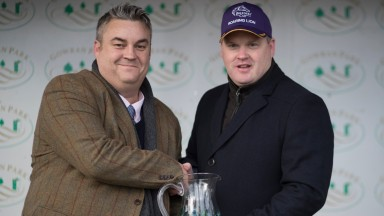 Eddie Scally: seen here making a presentation to Gordon Elliott, says not enough is being done to try get racegoers to return in Ireland