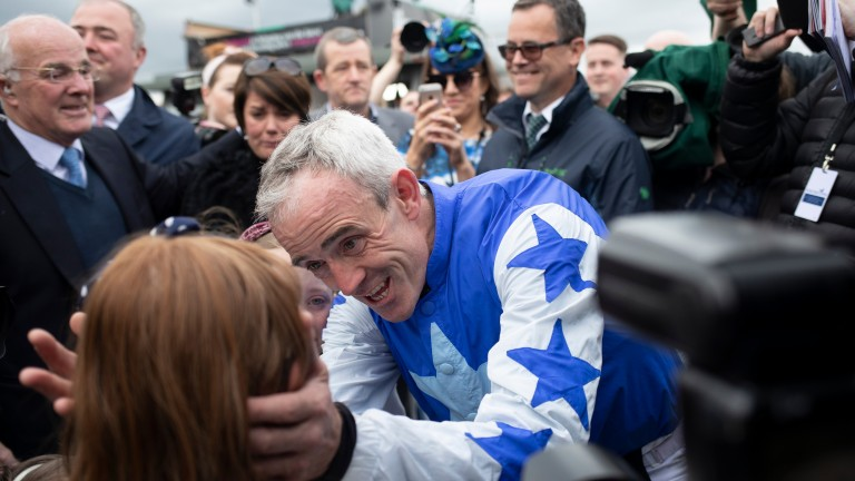 Ruby Walsh shares a moment with his children during an emotional day at Punchestown