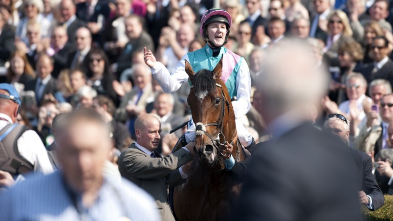 Tom Queally laps up the adulation of the crowd after Frankel's unbelieveable Guineas win