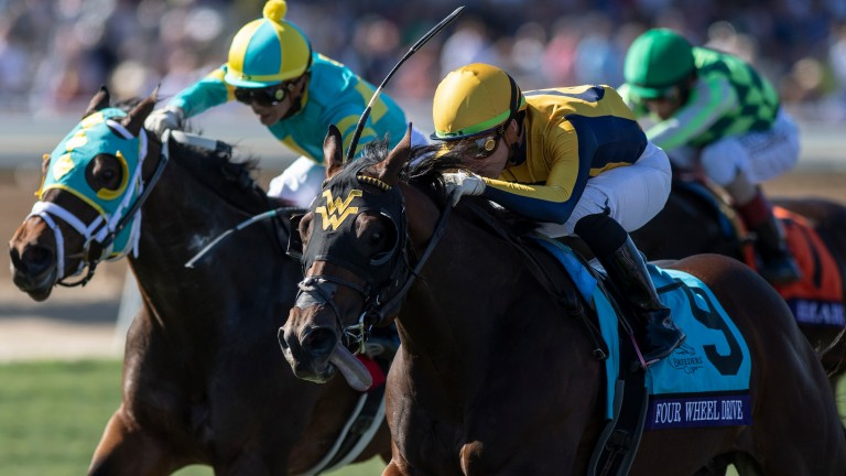 Four Wheel Drive (yellow and dark blue silks): in action at Churchill Downs on Sunday