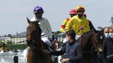 Jockeys return after a race at Chantilly, where face masks are mandatory at all time