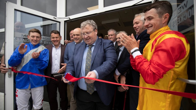 Brian Kavanagh flanked by jockeys Shane Foley and Colin Keane officially opens the new weighing room facility at Roscommon last year
