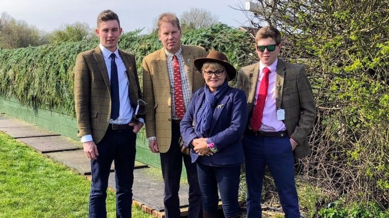 Tim Jones (right) with brother Christopher, father Simon and mother Sally during a trip to Aintree one month before he died