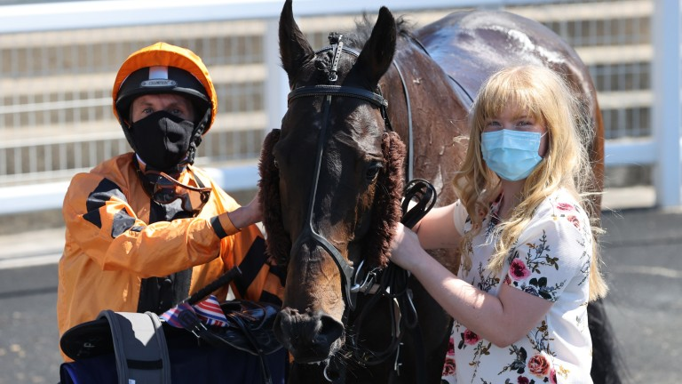 Zodiakos and James Sullivan pose after winning the opener at Newcastle